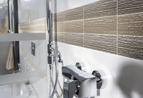 Evoking Gently Flowing Water The Rippled Texture Of Creekside Gl Tiles Boasts Translucency That Allows Light To Both Breach Surface And Diffuse Back