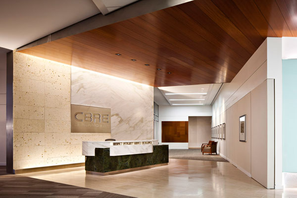 Cb richard ellis office dallas designed by hks inc doors showcase the texas shell stone and italian marble reception desk which sit in front of a glass wall featuring an etched world map and cbre logo gumiabroncs Gallery